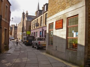 The front of the hostel and main street in Stromness