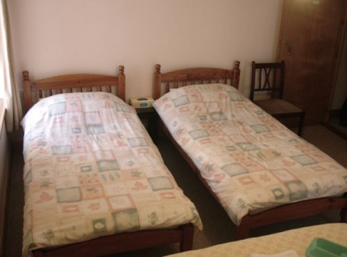 Two twins and one queen bed in the family room